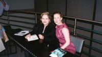 Renée with Ann Patchett signing copies of the program and the novel