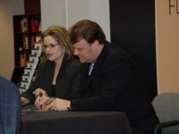 Renée and Bryn signing copies of their CD